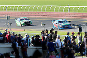 Mark Winterbottom & Steve Owen (Pepsi Max Ford) leading Shane van Gisbergen & Jonathon Webb. 2015 Wilson Security Sandown 500. V8 Supercars Championship Round 9. Sandown International Raceway, Victoria. Sunday 13 September 2015. Photo: Clay Cross / photosport.nz. 2015 Wilson Security Sandown 500. V8 Supercars Championship Round 9. Sandown International Raceway, Victoria. Sunday 13 September 2015. Photo: Clay Cross / photosport.nz