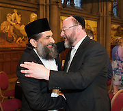 Photo by Howard Barlow  7 June 2015   A warm embrace between Chief Rabbi Ephraim Mirvis and Shaykh Ibrahim Mogra, both keynote speakers at Sunday's 10th Anniversary Dinner of the Greater Manchester Muslim Jewish Forum.