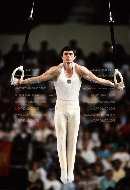 PHOENIX - APRIL 24:  Dimitri Belozerchev of the USSR competes on the still rings during a USA - USSR gymnastics meet on April 24, 1988  at the Arizona Veterans Memorial Coliseum in Phoenix, Arizona.  (Photo by David Madison/Getty Images)