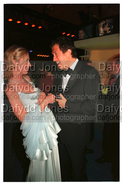 JOELY RICHARDSON; MARIO TESTINO.  Vanity Fair Oscar night party. Mortons. Los Angeles. 28 March 1999. Film 99185f12<br /> © Copyright Photograph by Dafydd Jones 66 Stockwell Park Rd. London SW9 0DA<br /> Tel 0171 733 0108<br /> www.dafjones.com
