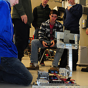 BRUNSWICK, Maine --  12/17/13 -- Pip Butterfield, 17, center, of Kennebunk High School drives his team's competition robot at Southern Maine Community College (SMCC) last Tuesday as teammates assess its progress. High School Students from Portland, Lewiston and Kennebunk gathered at SMCC's Brunswick center for their first robotics competition. A Bank of America grant to Portland and Lewiston started them up last spring -- giving an opportunity for young adults to work in teams to conceive, build, program and operate the small robots.  Photo © Roger S. Duncan 2013.