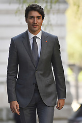 April 18, 2018 - London, England, United Kingdom - Prime Minister of Canada, Justin Trudeau arrives at Downing Street, ahead of a bilateral meeting with British Prime Minister Theresa May on April 18, 2018 in London, England. Mrs May holds bilateral talks with a number of Commonwealth leaders today as the UK this week hosts heads of state and government from the Commonwealth nations. (Credit Image: © Alberto Pezzali/NurPhoto via ZUMA Press)