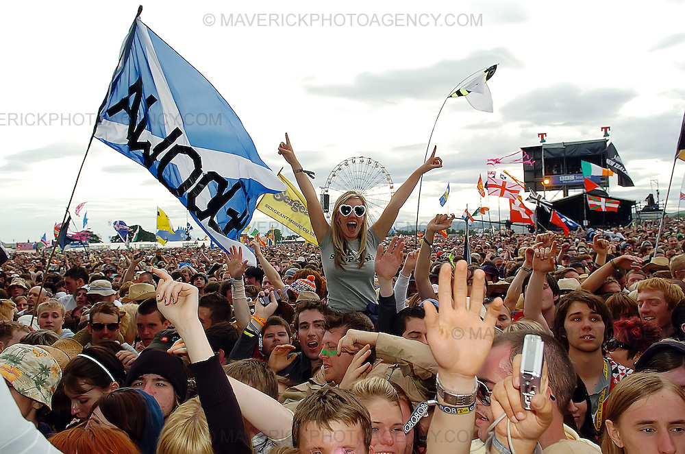 BALADO, KINROSS, SCOTLAND - JULY 13th 2008: Revellers enjoy watching bands perform live at T in the Park 2008.