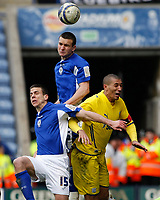 Photo: Steve Bond/Richard Lane Photography. Leicester City v Cardiff City. Coca Cola Championship. 13/03/2010. Jack Hobbs gets his head to the ball above Jay Bothroyd (R) and Bruno Berner (L)