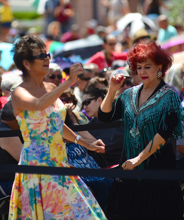 apl050717b/ASECTION/pierre-louis/JOURNAL 050717<br /> Martha Lucero,, left and Stella Bartone,, dance during the dedication  and renaming of Civic Plaza in honor of Al Hurricane ,  the Godfather of New Mexico Music .Photographed on Sunday May 7 2017. .Adolphe Pierre-Louis/JOURNAL