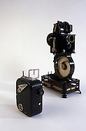 A 27.6 MG IMAGE OF:.The Pathex 9.5mm camera and projector. Both the camera and the projector were hand cranked.  The projector had a light bulb that was powered by the hand crank. ie. a mini generator.  It could also be powered by wall current.  The film was perforated in the center.  It was introduced in France in 1922 and in America three years later.  Photo by Dennis Brack