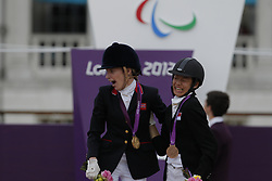 Christiansen, Sophie;<br /> Tan, Laurentia, <br /> London Paralympics 2012<br /> Siegerehrung Garde III + Garde 1a<br /> © www.sportfotos-lafrentz.de/ Stefan Lafrentz