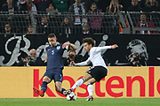 Gary Cahill (Captain) of England tackles Leroy Sane of Germany during the International Friendly match between Germany and England at Signal Iduna Park, Dortmund, Germany on 22 March 2017. Photo by Phil Duncan.