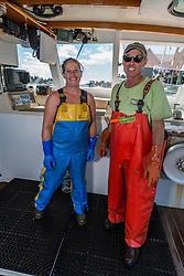Captain Steve Rosen, and Stern Woman Kachina Watt aboard 'Star Fisher' at the Vinalhaven Fishermen's Co-op in Vinalhaven, Maine.