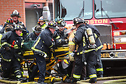 Mar 26, 2014 - Boston, Massachusetts, U.S. - <br /> <br /> Two Firefighters Killed in Boston Brownstone Blaze<br /> <br /> Fire crews work on a fellow firefighter pulled from the rear of 298 Beacon Street. Two Boston firefighters were killed Wednesday in a fire that ripped through a brownstone in a densely-populated neighborhood, a city councilor says. The fire started shortly before 3 p.m. in the four-story building in the city's Back Bay area.<br /> ©Exclusivepix