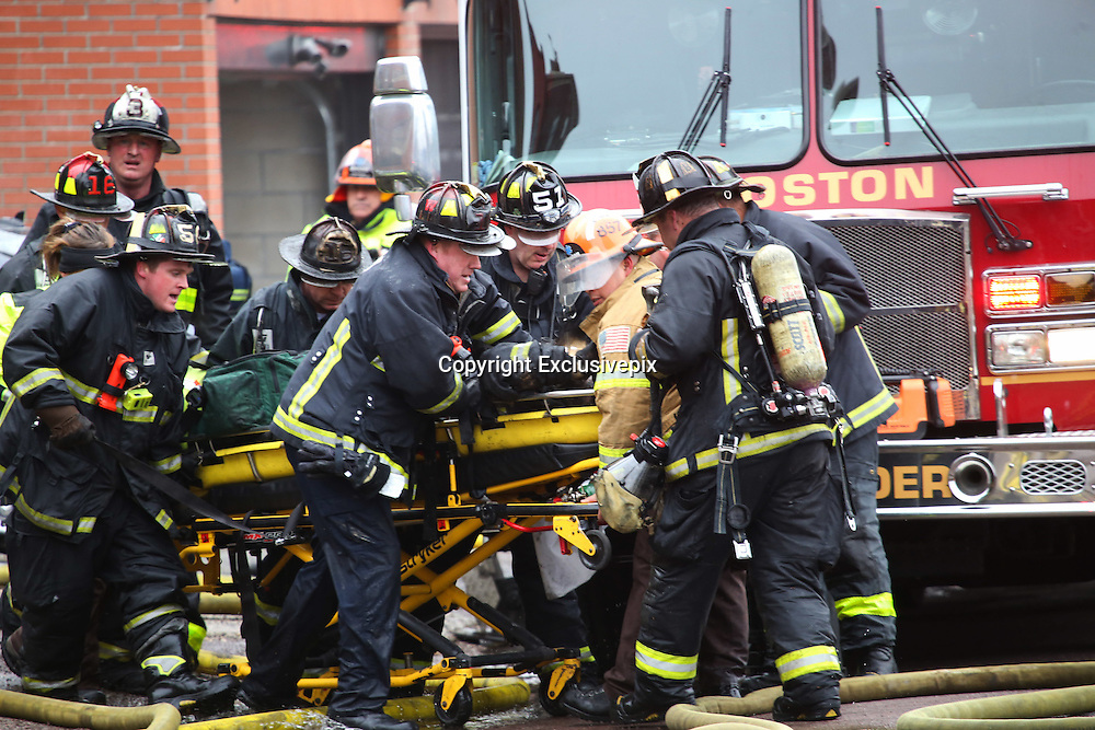 Mar 26, 2014 - Boston, Massachusetts, U.S. - <br /> <br /> Two Firefighters Killed in Boston Brownstone Blaze<br /> <br /> Fire crews work on a fellow firefighter pulled from the rear of 298 Beacon Street. Two Boston firefighters were killed Wednesday in a fire that ripped through a brownstone in a densely-populated neighborhood, a city councilor says. The fire started shortly before 3 p.m. in the four-story building in the city's Back Bay area.<br /> &copy;Exclusivepix