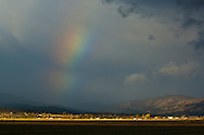 Distant rainbow over  Susanville, Lassen County, California