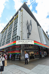 © Licensed to London News Pictures. 01/07/2019. LONDON, UK.  The John Lewis department store on Oxford Street is one of many retail stores in the capital's West End whose exteriors are decorated in rainbow colours in support of Pride Month.  Pride is an annual celebration of the LGBT+ community and culminates in the LGBT+ parade in the UK, with thousands of people travelling the route either by foot or on floats.  Photo credit: Stephen Chung/LNP