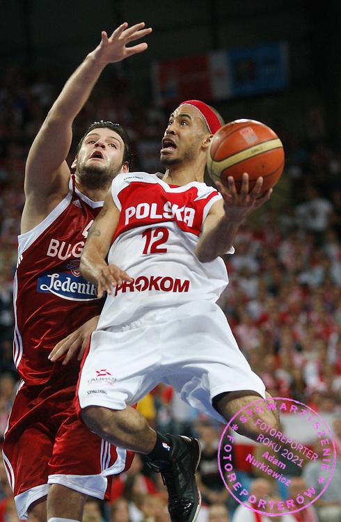 Wroclaw 07/09/2009.EuroBasket 2009.Preliminary Round - Group D.Poland v Bulgaria.David Logan of Poland and Deyan Ivanov of Bulgaria ..Photo by : Piotr Hawalej / WROFOTO