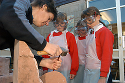 Creativity in schools - children in a primary school in North Yorkshire stone carving with local artist; UK