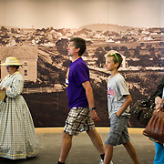 Visitors make their way past murals and civilian reenactors inside the Gettysburg National Military Park Visitors Center, during the Sesquicentennial Anniversary of the Battle of Gettysburg, Pennsylvania on Sunday, June 30, 2013.  A pivotal battle in the Civil War, over 50,000 soldiers died in the battle which spanned 3 days from July 1-3, 1863.  Later that year, President Abraham Lincoln returned to Gettysburg to deliver his now famous Gettysburg Address to dedicate the cemetery there for the Union soldiers who died in battle.  John Boal photography