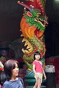 Malaysia, Kuala Lumpur. Chinatown. Dragon pillars at Guan Di Temple.
