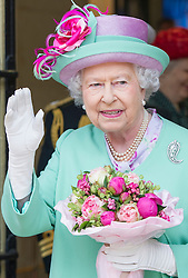 Image ©Licensed to i-Images Picture Agency. 12/06/2014. London, United Kingdom. In the frame - HM The Queen departing waving to children from the Burdett Coutts and Townshend C of E Primary school. <br /> HM The Queen today officially opens the new Westminster School's sports Centre for Westminster School. HM watched an array of sports including judo, fencing cricket and yoga. Picture by  i-Images