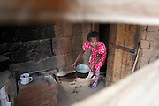 Sidonie doing the housework and cooking in the family home. <br /> <br /> Follow up visit to see Sidonie Haritiana (Patient No 074) who received surgery for her Unilateral Cleft Lip during Operation Smile&rsquo;s 2011 mission to Antananarivo when she was 7 years old. <br /> <br /> Sidonie is now 9 years old and lives with her Father Patrick, Mother Harinirima, Older Sister Chantale and younger sister Jafia. In a one room hut they rent near the brickworks which her mother and father work in. Sidonie attends school but as she is on summer holidays she helps her mother and father at work in the brick works.<br /> <br /> Outskirts of Antananarivo. Madagascar. 25th August 2014.<br /> <br /> (Operation Smile Photo - Zute Lightfoot)