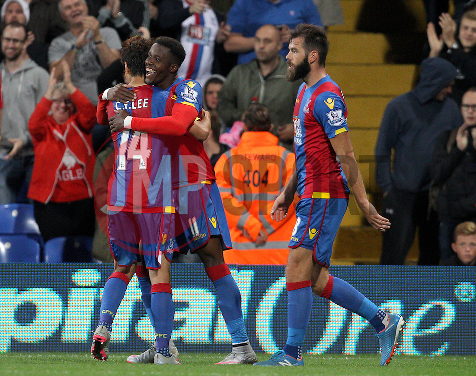 Wilfried Zaha ( C ) of Crystal Palace celebrates with Lee Chung-Yong ( L )  after he scores to make it 4-1 - Mandatory byline: Paul Terry/JMP - 07966386802 - 25/08/2015 - FOOTBALL - Selhurst Park -London,England - Crystal Palace v Shrewsbury town - Capital One Cup - Second Round