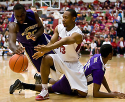 February 13, 2010; Stanford, CA, USA;  Washington Huskies forward Quincy Pondexter (20) grabs a loose ball from Stanford Cardinal guard Emmanuel Igbinosa (13) during the first half at Maples Pavilion.  Washington defeated Stanford 78-61.