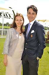 FRANCOIS LE TROQUER MD of Cartier Ltd. and his wife LIUDMILA at the Cartier Queen's Cup Polo Final, Guards Polo Club, Windsor Great Park, Berkshire, on 17th June 2012.