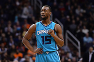 Jan 6, 2016; Phoenix, AZ, USA; Charlotte Hornets guard Kemba Walker (15) looks on during the game against the Phoenix Suns at Talking Stick Resort Arena. The Phoenix Suns defeated the Charlotte Hornets 111-102. Mandatory Credit: Jennifer Stewart-USA TODAY Sports