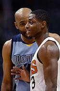 Mar 21, 2016; Phoenix, AZ, USA; Phoenix Suns guard Brandon Knight (3) talks with Memphis Grizzlies guard Vince Carter (15) in the game at Talking Stick Resort Arena. The Memphis Grizzlies won 103-97. Mandatory Credit: Jennifer Stewart-USA TODAY Sports