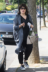Daily Mail columnist and wife of Tory Leadership hopeful Sarah Vine arrives home on Sunday morning as her Husband appears on the Andrew Marr Show.