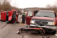 Ohio State Patrol trooper Frank Simmons takes pictures during the investigation of an accident at the intersection of westbound US 35 and Trebein Road near Xenia, Saturday, March 26, 2011.