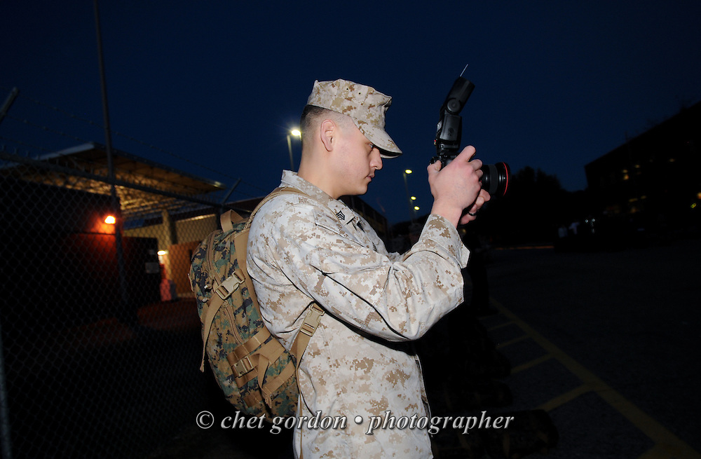 A Marine Corps Sgt. uses a DSLR camera to record video before sunrise at the Marine Corps Recruit Depot (MCRD) in Parris Island, SC on Wednesday morning, March 13, 2013.