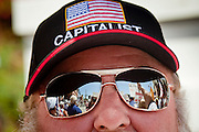 17 AUGUST 2009 -- PHOENIX, AZ: The anti-health care reform protestors were reflected in the sunglasses John Johnson (CQ) from Phoenix. About 5,000 people were expected to demonstrate in favor of President Obama's health care proposals. Nearly 1,500 showed up to demonstrate against the President.  PHOTO BY JACK KURTZ