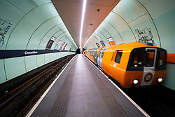 Glasgow, Scotland, UK. 1 April, 2020. Effects of Coronavirus lockdown on streets of Glasgow, Scotland. Empty platform as train on Glasgow Subway arrives at station. Iain Masterton/Alamy Live News