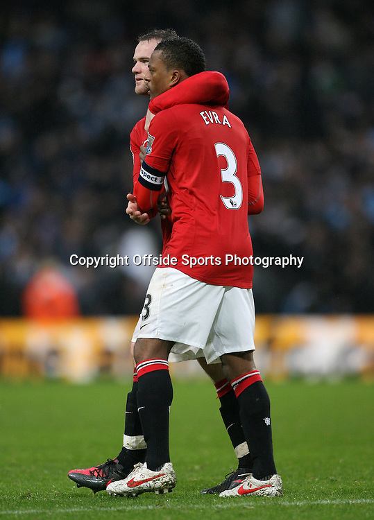 08/01/2012 - FA Cup 3rd Round - Manchester City vs. Manchester United - Wayne Rooney of Man Utd (L) and Patrice Evra of Man Utd celebrate victory - Photo: Simon Stacpoole / Offside.