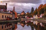 Vivid sunrise clouds above the Vltava River in Cesky Krumlov, Czech Republic