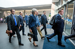 © Licensed to London News Pictures. 02/10/2017. Manchester, UK. British prime minister THERESA MAY (centre) seen walking through the conference hall at the second day of the Conservative Party Conference. The four day event is expected to focus heavily on Brexit, with the British prime minister hoping to dampen rumours of a leadership challenge. Photo credit: Ben Cawthra/LNP