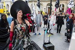 London, UK. 2 July, 2019. Climate change activists from Extinction Rebellion Art and Culture protest outside the offices of Repsol S.A. during a silent procession visiting the offices of five major oil companies - ENI, CNPC, Saudi Aramco, Repsol and BP - to declare them a crime scene.