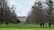 © Licensed to London News Pictures. 7/02/16. Hampton Wick. People enjoy a Sunday afternoon walk in the sunshine at Home Park with Hampton Court Palace as a backdrop. The weather continues to be unsettled with sunshine and showers. Photo credit : Stephen Simpson/LNP