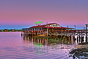 The Santa Maria Restaurant in historic downtown St. Augustine, Florida reflected in the Matanza's River at sunset.