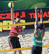 STARE JABLONKI POLAND - July 4: Adrian Gavira Collado of Spain and Bruno Oscar Schmidt of Brazil in action during Day 4 of the FIVB Beach Volleyball World Championships on July 4, 2013 in Stare Jablonki Poland.  (Photo by Piotr Hawalej)