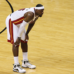 Jun 19, 2012; Miami, FL, USA; Miami Heat small forward LeBron James (6) reacts during the second quarter in game four in the 2012 NBA Finals against the Oklahoma City Thunder at the American Airlines Arena. Mandatory Credit: Derick E. Hingle-US PRESSWIRE