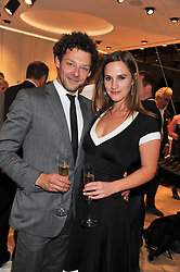 RICHARD COYLE and RUTH BRADLEY at the launch of the Spencer Hart Flagship store, Brook Steet, London on 13th September 2011.