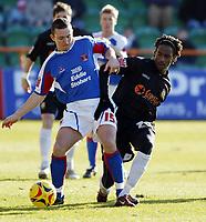 Photo: Chris Ratcliffe.<br />Barnet FC v Carlisle United. Coca Cola League 2. 25/02/2006.<br />Jason Norville of Barnet (R) chases Paul Arnison of Carlisle.