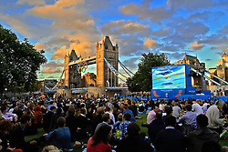 Crowds watch swimming heats on a large screen at Potters Fields Park Wednesday, Aug. 1, 2012 in London. Live venues throughout London gave fans who could not get tickets the opportunity to gather and watch the Olympics live.