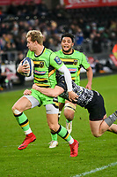 Rugby - 2017 / 2018 European Rugby Champions Cup - Pool Two: Ospreys vs. Northampton Saints<br /> <br /> Hary Mallinder of Northampton Saints tackled by Jeff Hassler of Ospreys with  a man outside , at the Liberty Stadium.<br /> <br /> COLORSPORT/WINSTON BYNORTH