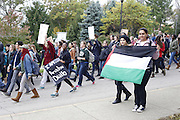 Caroline Zakhary, a junior at Ohio University, and Amneh Shehavi, a member of Palestinian Solidarity Group (based in Columbus, Ohio), march with the Palestinian flag because all these issues are intertwined and are stonger when we work together to create change. Photo by Olivia Wallace