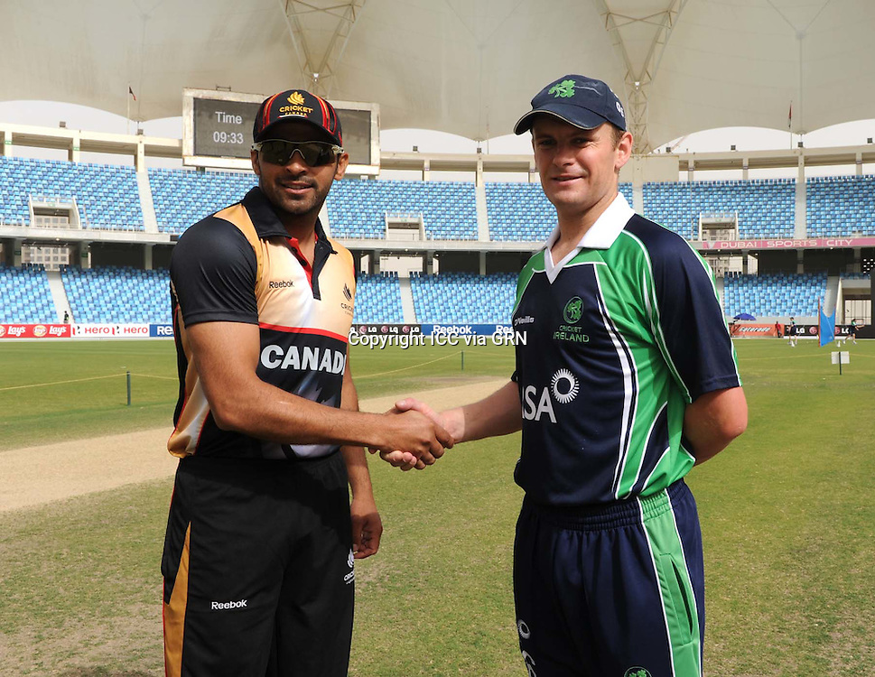 ICC World Twenty20 Qualifier UAE 2012.Ireland take on Canada at the Dubai International Cricket Stadium, Dubai, on the first day of the tournament play offs..Pic shows Canadian captain, Rizwan Cheema flips the coin as Ireland skipper, William Porterfield and match referee, Mr David Jukes look on. Canada won the toss and chose to bat..
