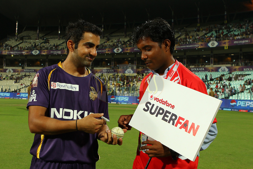 Gautam Gambhir signs the ball for the Vodafone Superfan during match 17 of the Pepsi Indian Premier League between The Kolkata Knight Riders and the Sunrisers Hyderabad held at the Eden Gardens Stadium in Kolkata on the 14th April 2013..Photo by Ron Gaunt-IPL-SPORTZPICS  ..Use of this image is subject to the terms and conditions as outlined by the BCCI. These terms can be found by following this link:..http://www.sportzpics.co.za/image/I0000SoRagM2cIEc