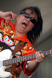 29 April 2012. New Orleans, Louisiana,  USA. <br /> New Orleans Jazz and Heritage Festival. <br /> Legendary guitar player June Yamagishi of Papa Grows Funk.<br /> Photo credit; Charlie Varley/varleypix.com