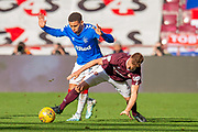 James Tavernier (#2) of Rangers FC tackles Oliver Bozanic (#7) of Heart of Midlothian FC during the Ladbrokes Scottish Premiership match between Heart of Midlothian and Rangers FC at Tynecastle Park, Edinburgh, Scotland on 20 October 2019.